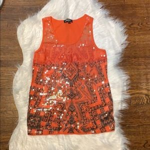 Orange sequin tank top with tribal print